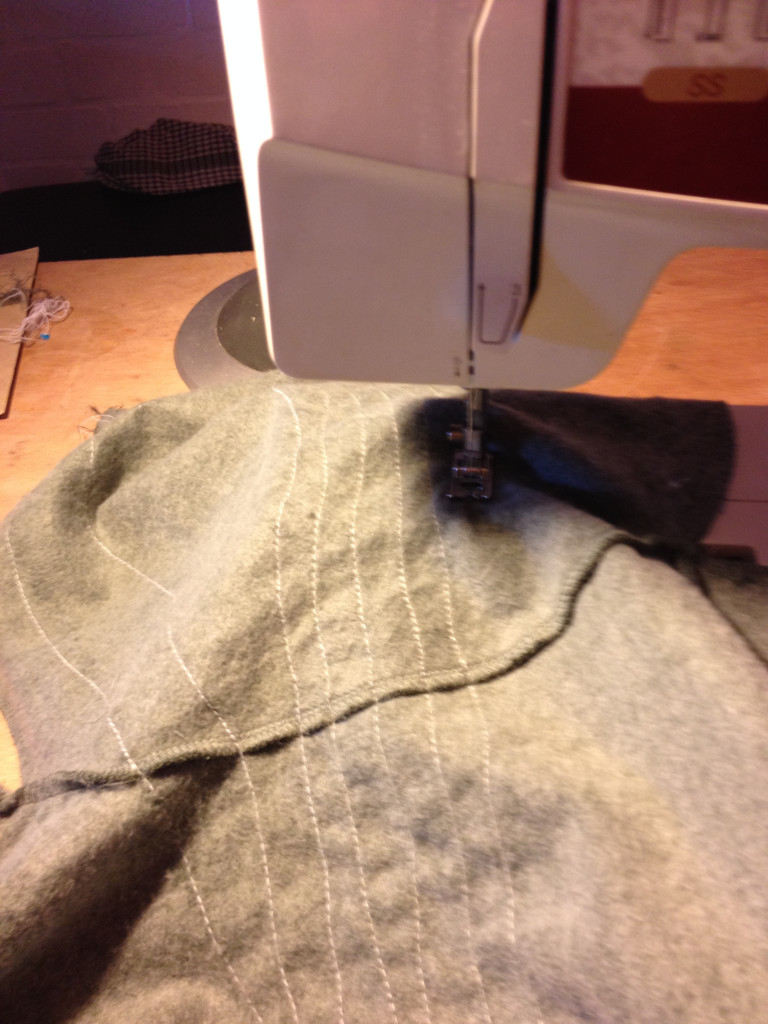 Sewing the thread along one of the sleaves